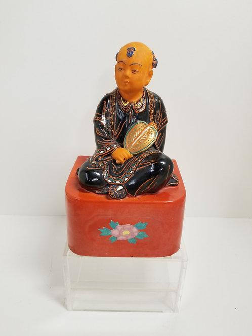 Japanese Ceramic figure of seated boy