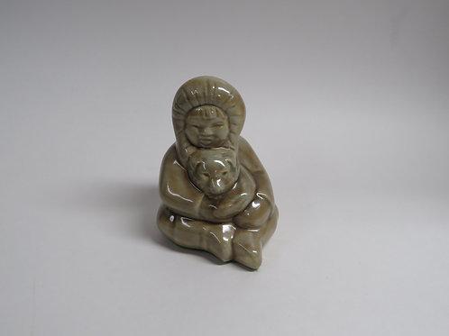 A glazed ceramic seated figure Canada