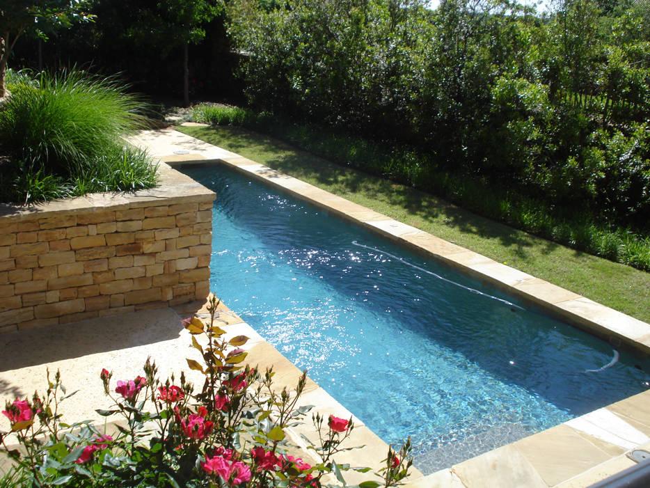 Beautiful lap pool landscape design by Tom Pritchett
