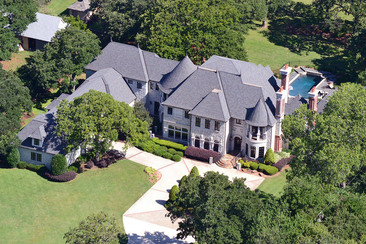 Aerial view of home's beautiful landscape design by Tom Pritchett