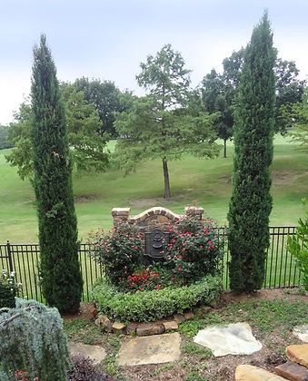Cypress trees and beautiful landscape design by Tom Pritchett