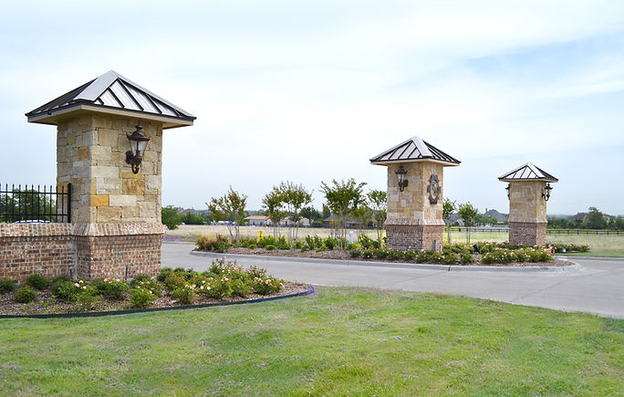 Beautiful residential community entrance and landscape design by T.H.Pritchett/Associates