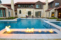 Amazing pool and landscape design by T.H.Pritchett/Associates with firepit