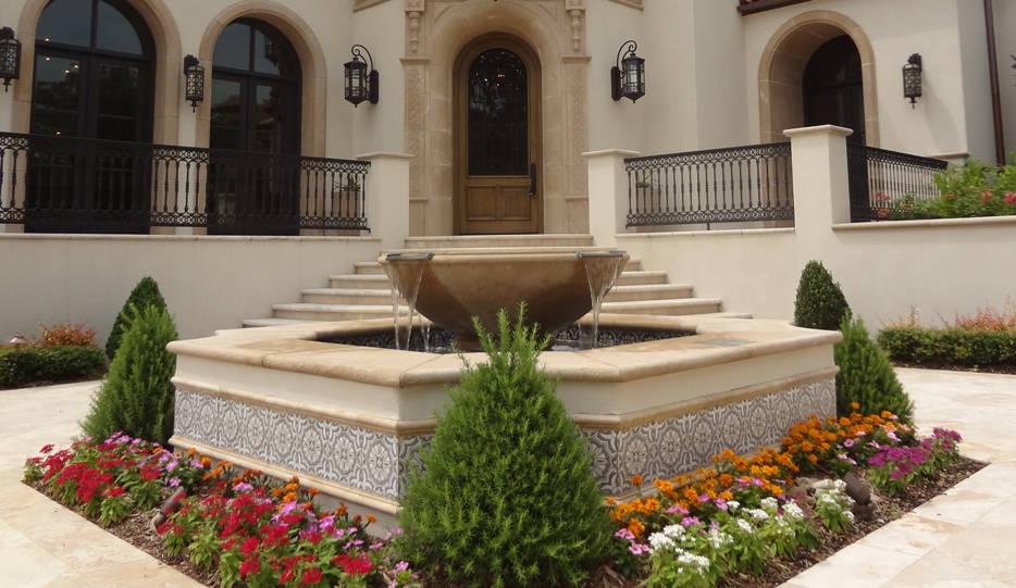 Beautiful front fountain landscape design by Tom Pritchett