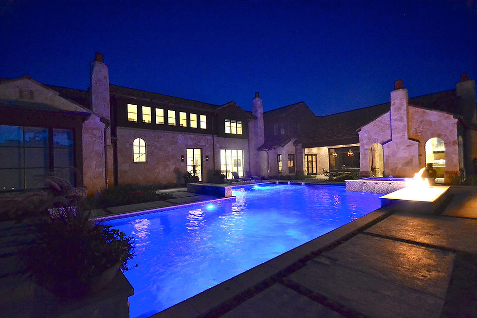 Nighttime amazing pool and landscape design by Tom Pritchett