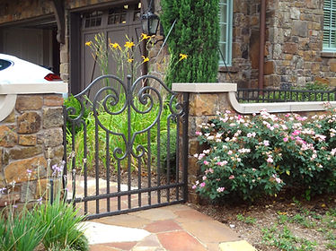 Iron pedestrian gate and landscape design by Tom Pritchett