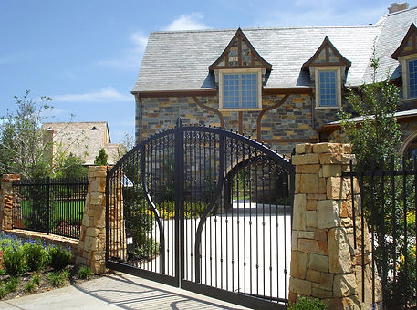 Beautiful iron driveway gate designed by Tom Pritchett landscape architect