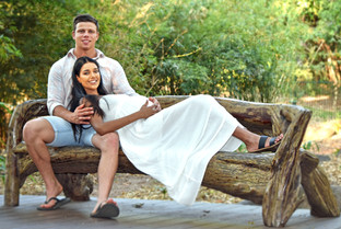 Young couple expecting first baby, resting in the garden