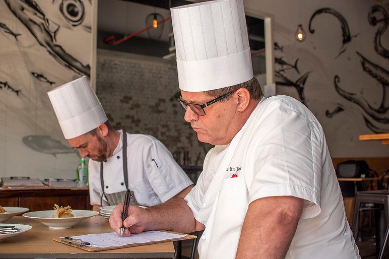 Chefs planning their menus