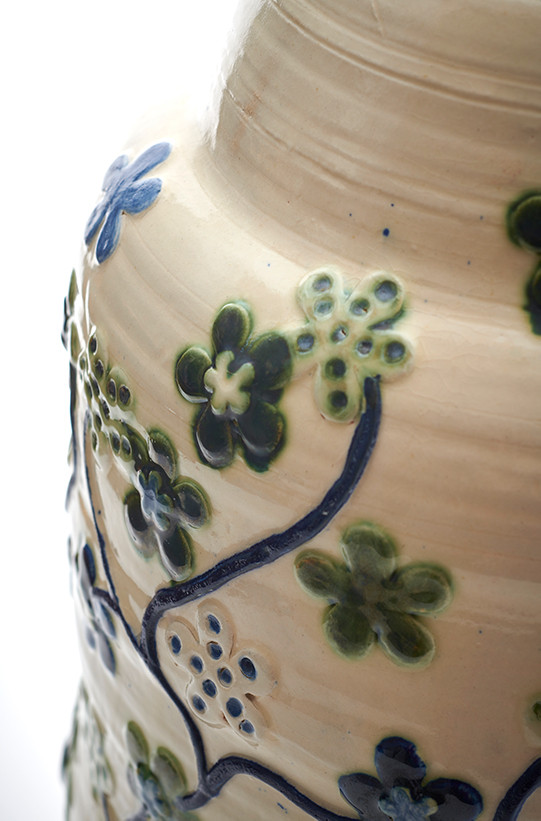 large pot with green flowers (detail)