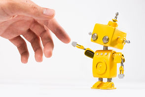 Cute, yellow, handmade robot with a huma