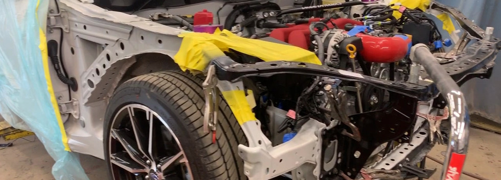 Subaru BRZ getting a new core support welded in and 3D measured.