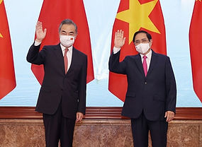 Vietnamese Prime Minister Pham Minh Chinh (R) meets with Chinese State Councilor and Foreign Minister Wang Yi in Hanoi, capital of Vietnam, September 11, 2021