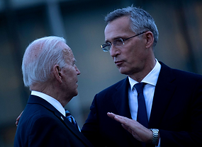 U.S. President Joe Biden and NATO Secretary General Jens Stoltenberg (R) talk at a memorial for the September 11 terrorist attacks on the United States after a summit at NATO Headquarters in Brussels, June 14, 2021