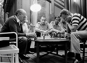 Menachem Begin and Zbigniew Brzezinski playing chess at Camp David