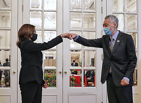 US Vice-President Kamala Harris makes a fist bump with Singaporean Prime Minister Lee Hsien Loong