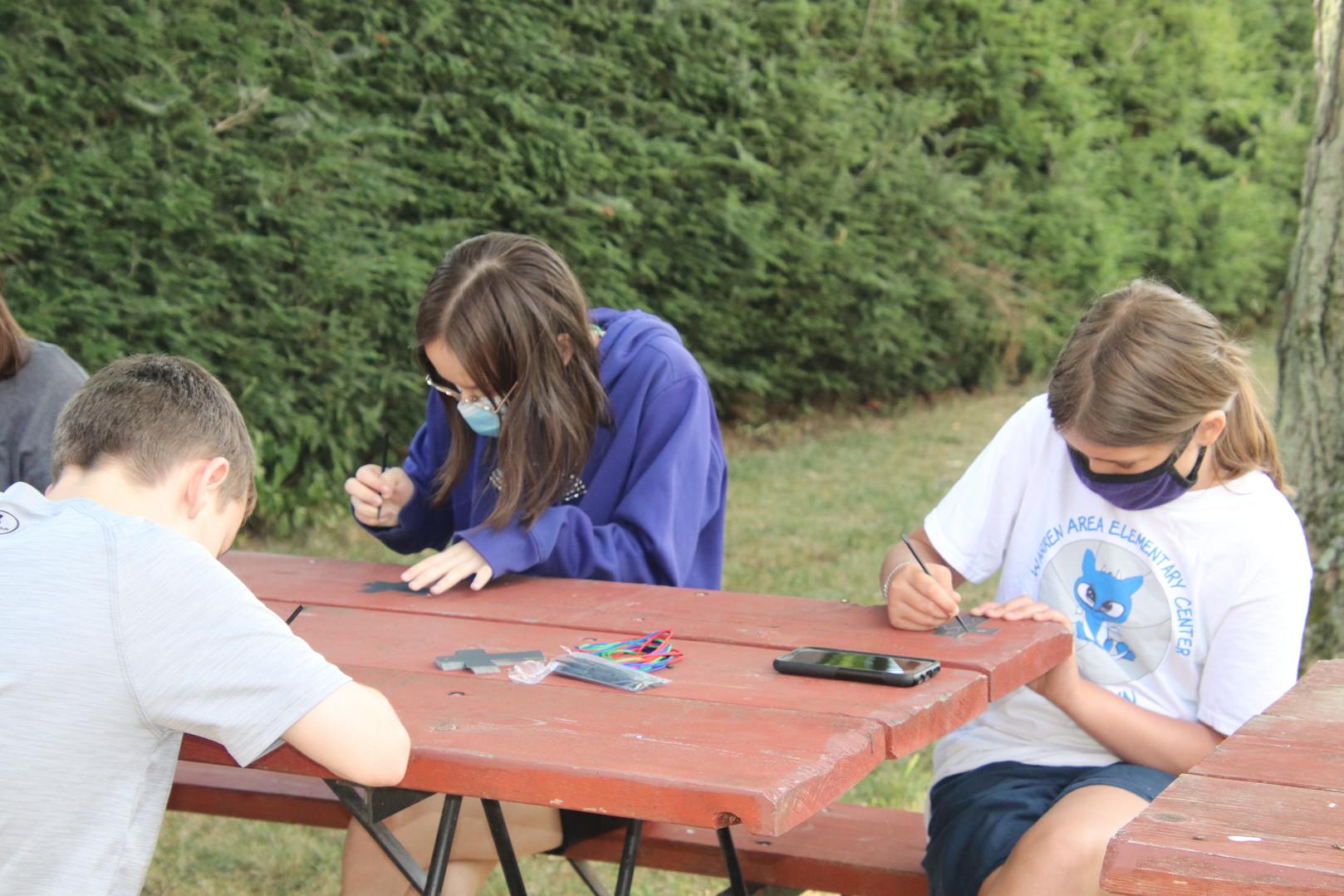 kids at picnic table.JPG