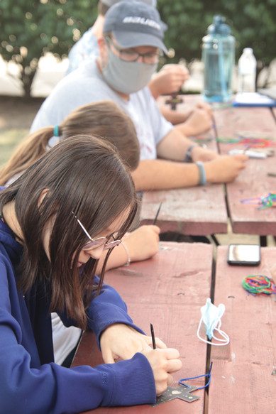 coloring crosses at the picnic table.JPG