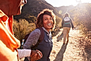 Woman Helping Man On Trail As Group Of S