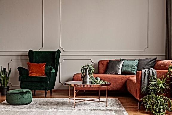 Velvet emerald green armchair with orang