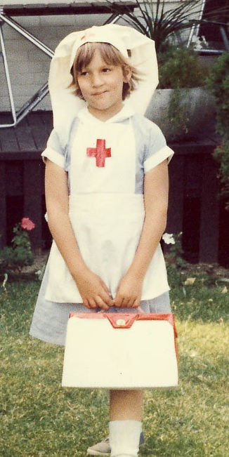Louise as a kid nurse pic.jpg
