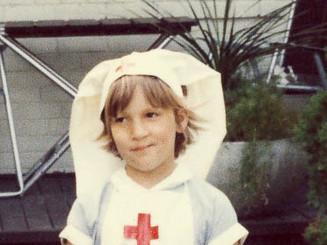 Louise as a kid nurse pic.jpg