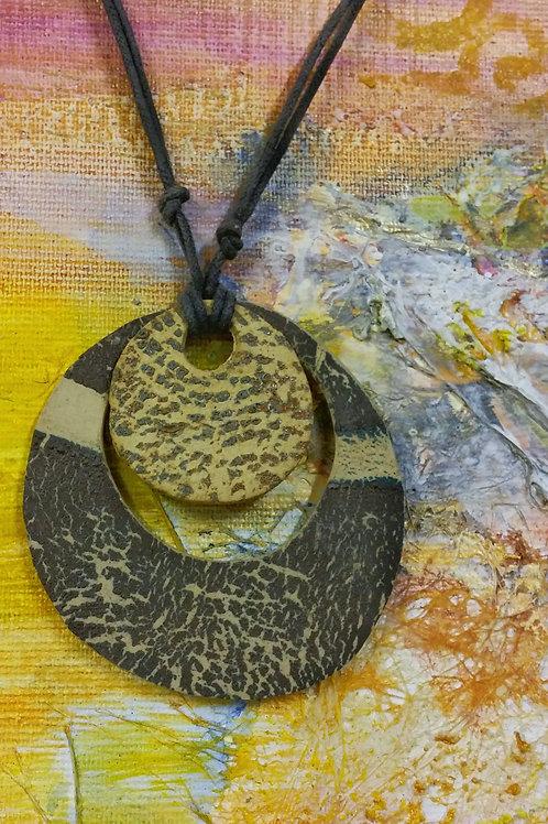 Central medallion necklace.