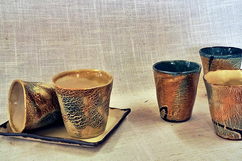 Faceted hot and cold drinking cups