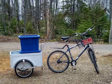 An amish cart makes hauling bins easy.