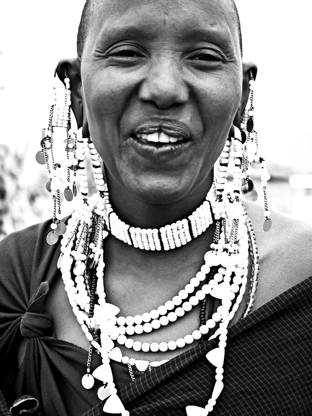 Maasai woman wearing traditional Maasai necklaces and earrings.