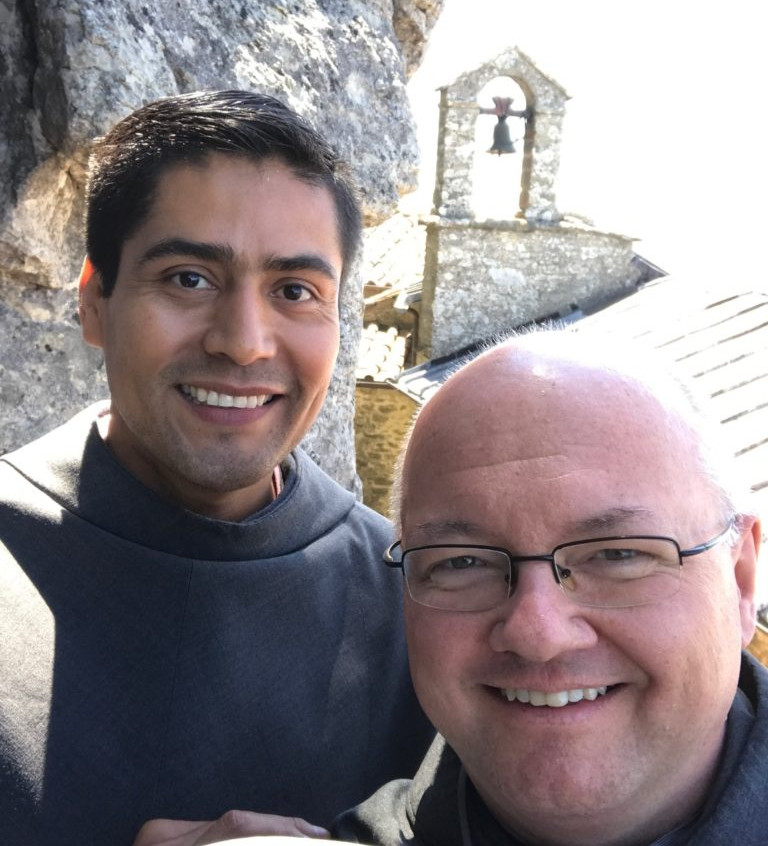 Fr. Brad Milunski, OFM Conv. (Our Lady of the Angels Province Vicar Provincial and one of the Pilgrimage Leadership Staff) with our own friar Luis Palacios Rodriguez, OFM Conv. (left) outside the cave of Brother Leo; St. Francis' secretary and friend.