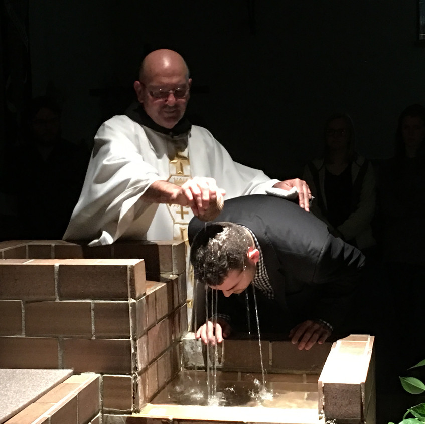 Father Gerry baptized a student during Easter Vigil Mass.