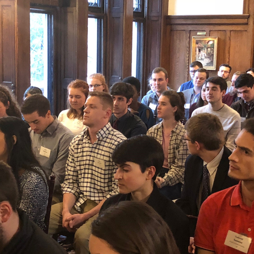 Students fill the room at the 'Cuse House