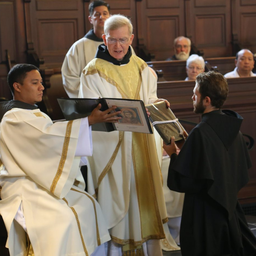 Friar Jason is presented with the Rule of the Order.
