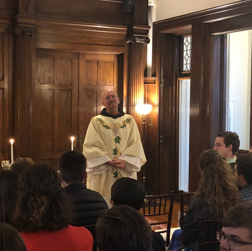 Father Gerry Waterman celebrating Mass