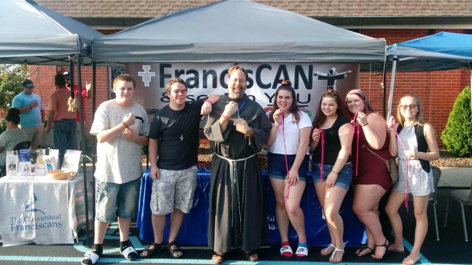 Brandon Greene (black shirt) and Friar John Bamman