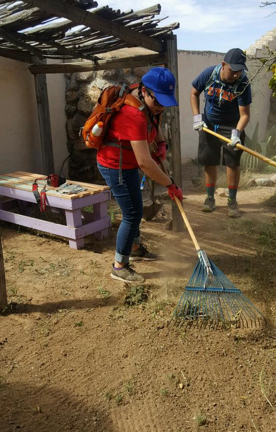 Student, Evelyn Perales and Jacob Samaniego working on the church grounds.