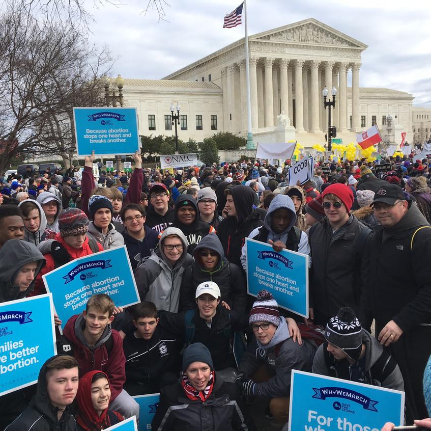 Students and Friar Matt at a pro-life rally