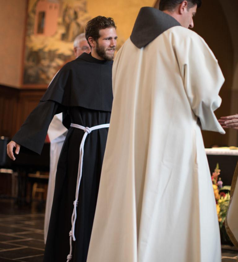 Friar Jason receiving his new cord