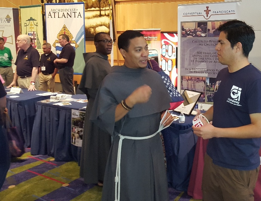 Friar Max and friar Franck manning the booth