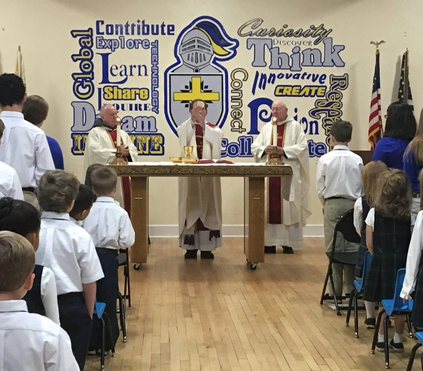 November 2016: Our Lady of the Angels Province friars, Fr. Paul Lininger, OFM Conv. (at left) and Fr. Briant Cullinane, OFM Conv. (at right) welcomed Most Reverend Michael F. Burbidge to Blessed Sacrament School, Burlington to celebrated his his final school Mass before his departure to the Diocese of Arlington.