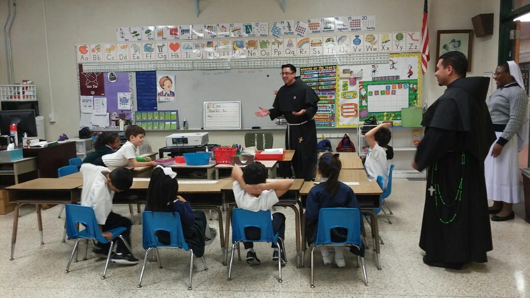 Calin talking to kindergarten students about vocations.