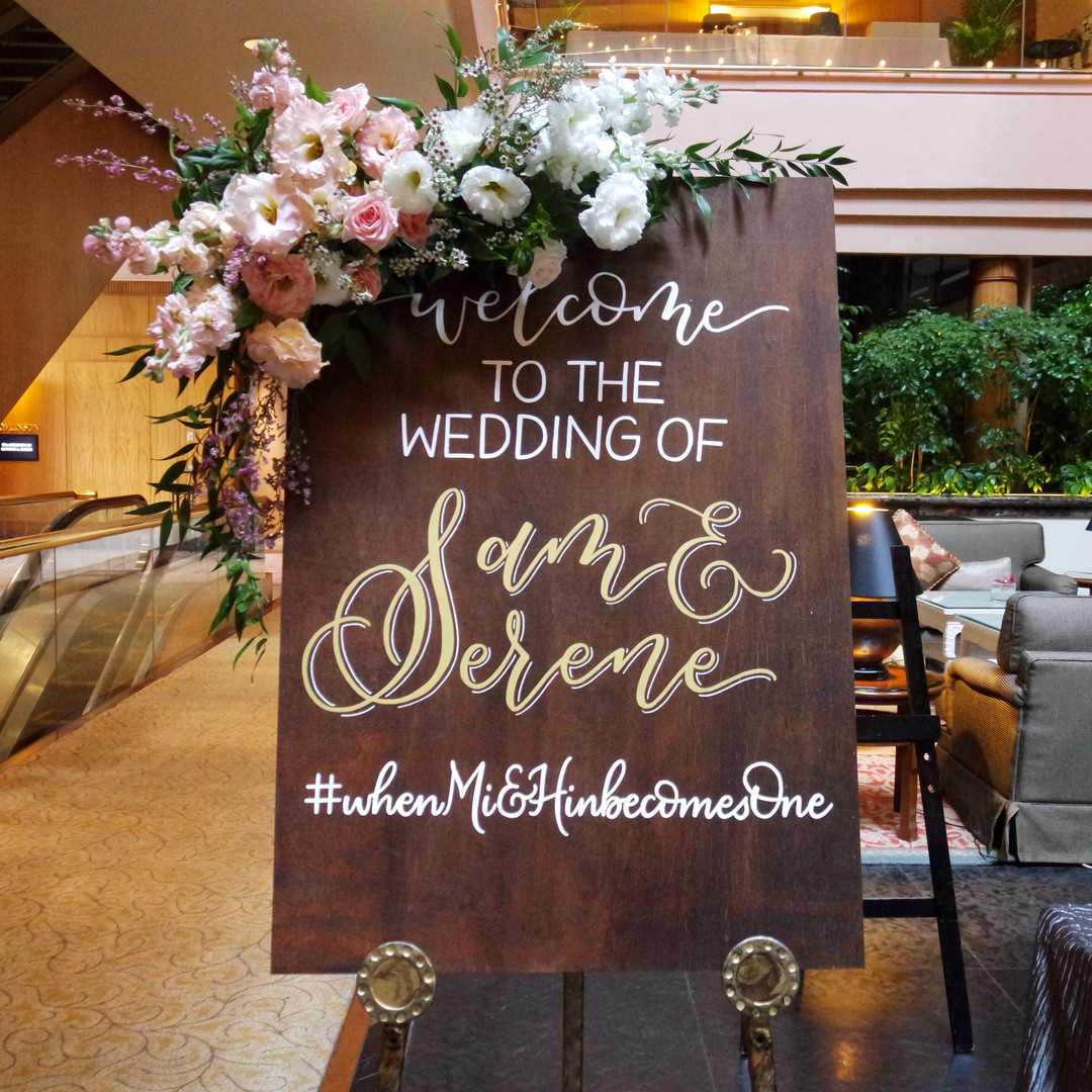 Welcome sign with flowers.jpg