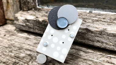 Playful and tactile brooches created in just One colour! These brooches are the second result of an exploratory project/challenge, featuring elements created in walnut,enamel, formica and silicone £90