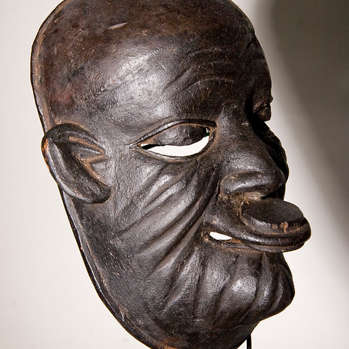 Makonde mask of female ancestor with lip plug, Tanzania. African tribal mask