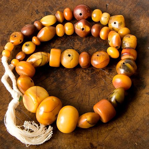 Strand of vintage graduated African phenolic 'amber' beads. Cross drilled
