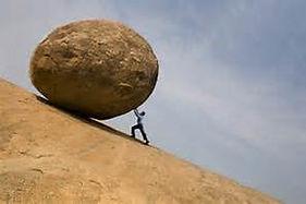 Man pushing boulder uphill.jpg
