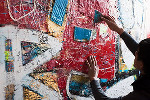 Artist Painting a Mural
