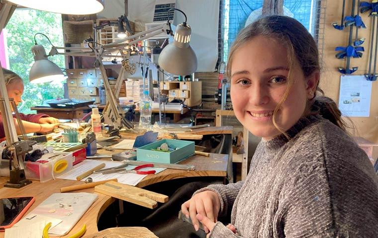 Happy student enjoying the creative process