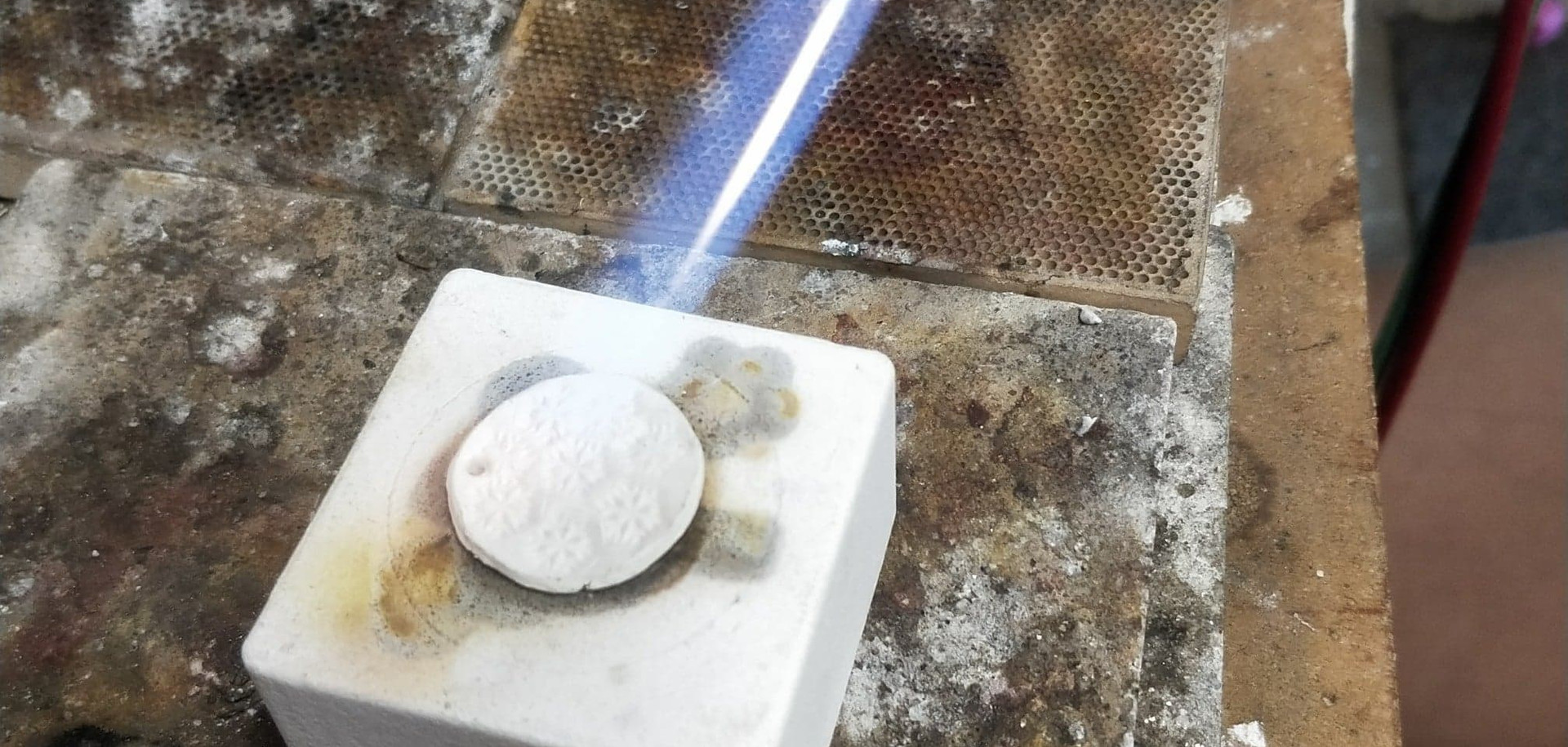 Torch firing the clay